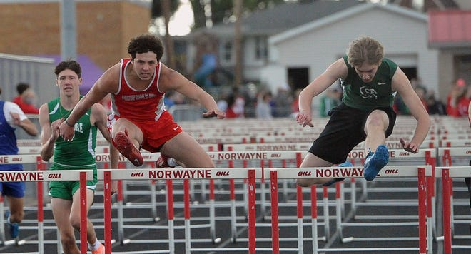 Norwayne's Nic Graham and Smithville'x Alex Taylor are neck and neck as they clear the final hurdle in the boys 110 meter hurdles. Taylor eked out the win.