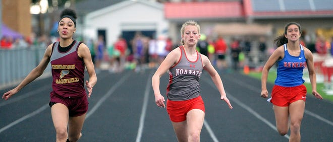 Kenmore Garfield's Briana Bunkley just edges out Norwayne Lacey Hess  in the 100-meter dash. Hess earned the win in the 200 later in the evening.