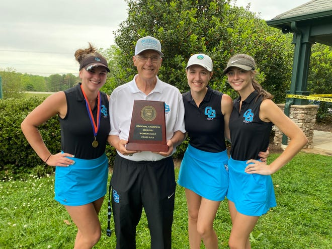 Oak Grove golf coach Vaughn Black holds the regional championship trophy. The Grizzlies playing as a team for the 1-A/2-A state championship are (from left) Emma Maddock, Sarah Stewart, and Kaitlyn McDonell. [Contributed photo]
