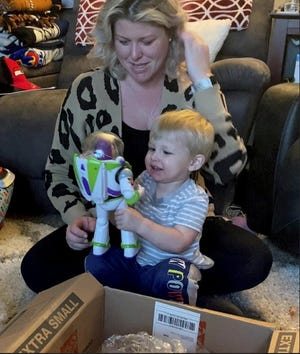 Two-year-old Hagan Davis is glad to have his Buzz Lightyear back.