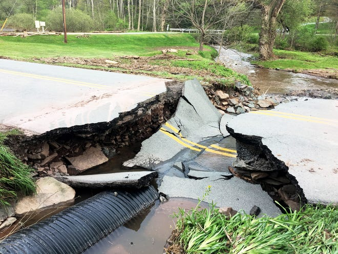 Tuesday night's storm wreaked havoc all across Wayne and Pike Counties. Pictured here is a section of the Brook Road that collapsed when a drainage pipe and culvert were overwhelmed by the massive amount or run-off.
