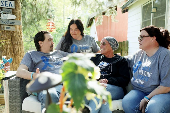 """Machell Chapin with her children, Steven """"Spike"""" Kirkpatrick, Nichole Peterson and Stacy Reid, Thursday on her healing deck attached to her Burlington home. The deck was built by her husband, Sean, and several other family members. Chapin is undergoing maintenance treatment for Stage 4 colon cancer."""