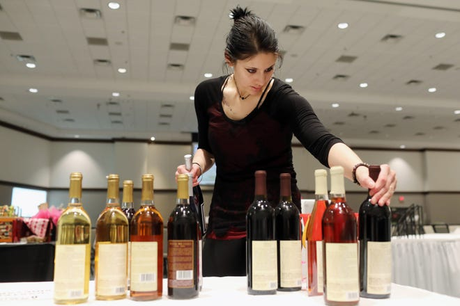 Alicia Levesque, a bartender at Baxter's Vineyards and Winery of Nauvoo, Illinois,  arrange bottles of wine from dry to sweet, while setting up for the annual Southeastern Community College Foundation Great Taste event, Friday April 12, 2019 at the Pzazz Entertainment Complex in Burlington. Money raised supports the SCC Foundation Board Scholarships, instructional program mini-grants, facilities improvements, and other college projects. Great Tastes will start at 6 p.m. Friday, Nov. 5, at Pzazz Event Center, stepping into a venerable spot on the calendarÊformerly occupied for decades by Burlington Fine Arts League Gala.