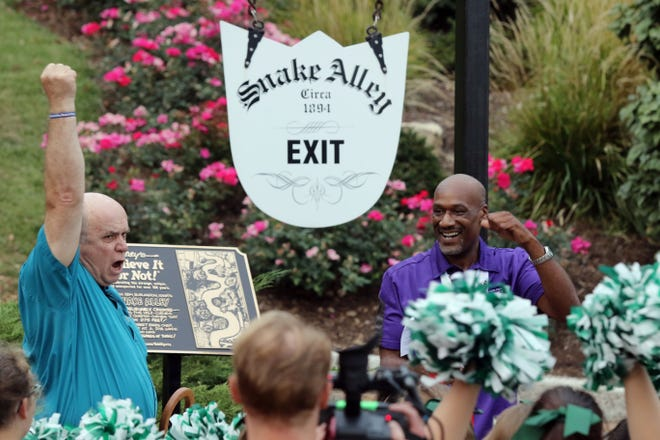 Edward Meyer, Vice President Exhibits and Archives with Ripley's Believe It or Not! and Burlington mayor Shane McCampbell cheer after a plaque declaring Snake Alley unbelievably crooked was unveiled during a ceremony after the Fireball Run Adventure Rally finished for the day Tuesday Sept. 26, 2017 in downtown Burlington.