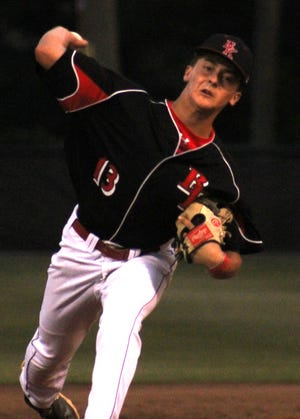 Bishop Kenny's Garrett Corbett delivers a pitch against Port Orange Atlantic during the FHSAA first round.