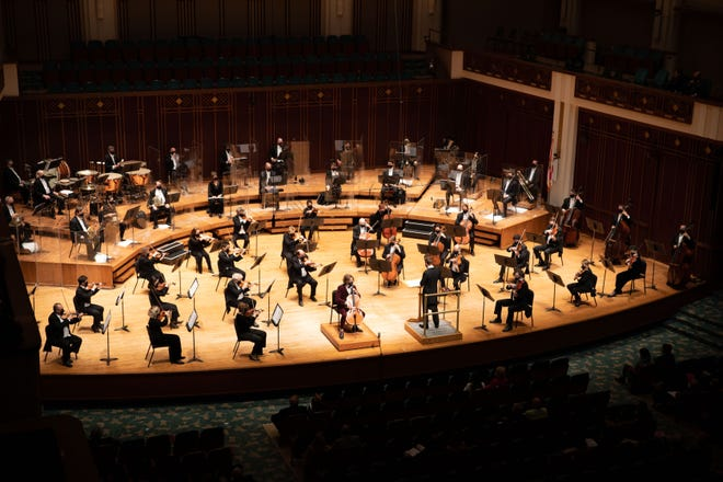Members of the Jacksonville symphony spread out on the stage while performing during the COVID-19 pandemic. Legislation pending before City Council would use $1 million in federal CARES Act money to help the symphony weather the financial storm.