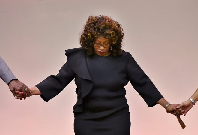 Former U.S. Rep. Corrine Brown joins in a prayer during a Martin Luther King Jr. breakfast in 2018 at Shiloh Church in Orange Park two weeks before Brown was scheduled to report to prison.