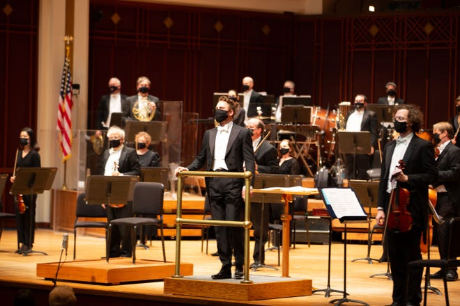 Courtney Lewis and the players in the Jacksonville Symphony wear face coverings during performances at the Times-Union Center.