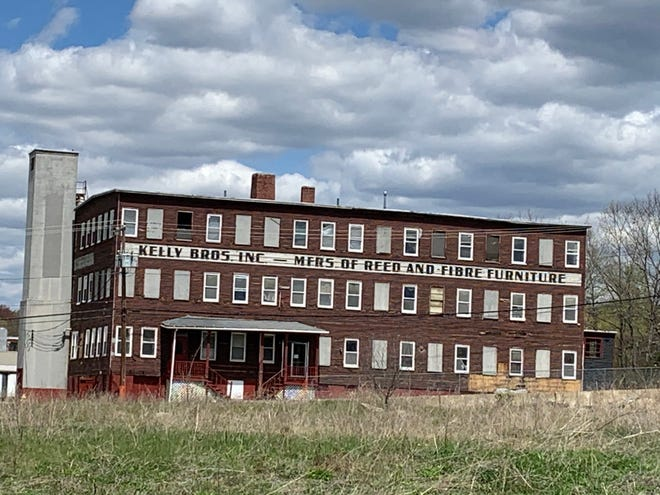 Crews recently removed the siding from the former Factory Coop building on Logan Street in Gardner and revealed the sign from the furniture manufacturer that was originally housed there.