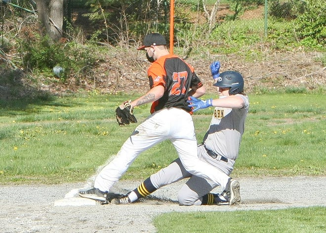 Gardner High third baseman Saviel Rivera beats Quabbin's Colin Wallace to the bag for a force out during Thursday afternoon's game at Stone Field in Gardner.