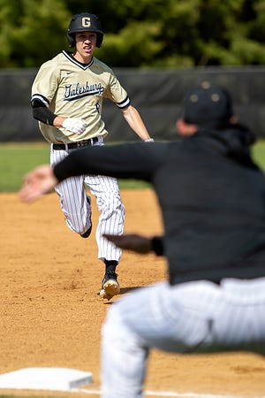 Galesburg High School baseball coach Jeremy Pickrel, right, directs John Knapp to slide on a play at third base during the Silver Streaks' 5-3 WB6 Conference win over Moline in the first game of a doubleheader on Thursday, May 6, 2021 at Jim Sundberg Field.