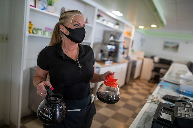 Waitress Dava Goedeke delivers fresh coffee to waiting customers at Judy's Family Cafe, 1195 N. Broad St., on Thursday.