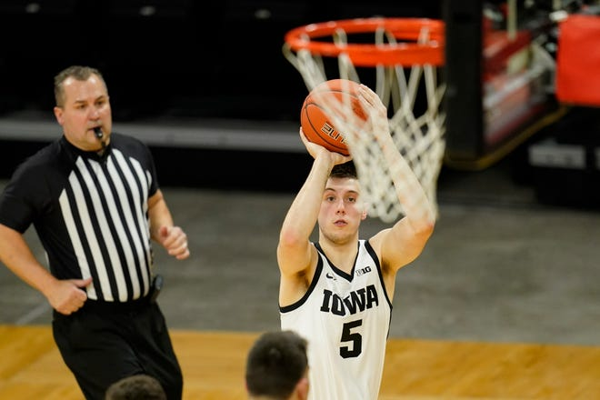 Iowa guard CJ Fredrick shoots during the first half of a game against Penn State on Sunday, Feb. 21, 2021, in Iowa City, Iowa.
