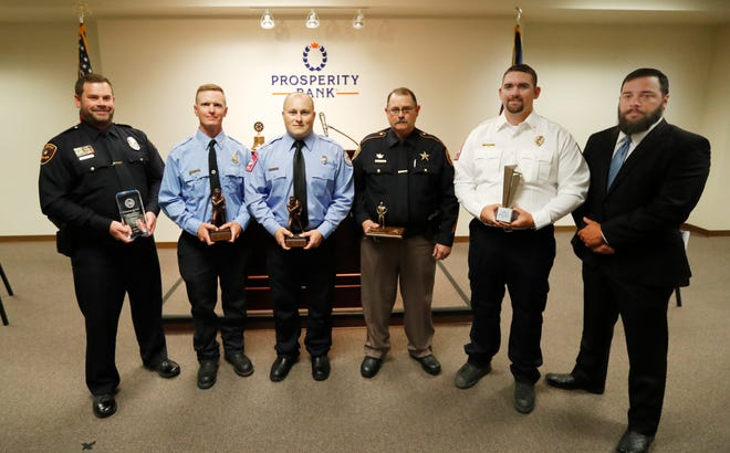 Honorees, from left, Officer Sean Dickson, Lubbock Fire Rescue Captain Brian Stephens, Lubbock Fire Rescue Firefighter Michael Davis, Lubbock County Sheriff's Office Sgt. Deon Clements, EMS Logistics Chief Brent Fox and Texas Department of Public Safety Special Agent Benjamin Wolf. The Rotary Club of Metropolitan Lubbock and Prosperity Bank held their Eighteenth Annual Unsung Heroes event to honor local responders for their actions in the field, Thursday, May 6, 2021.