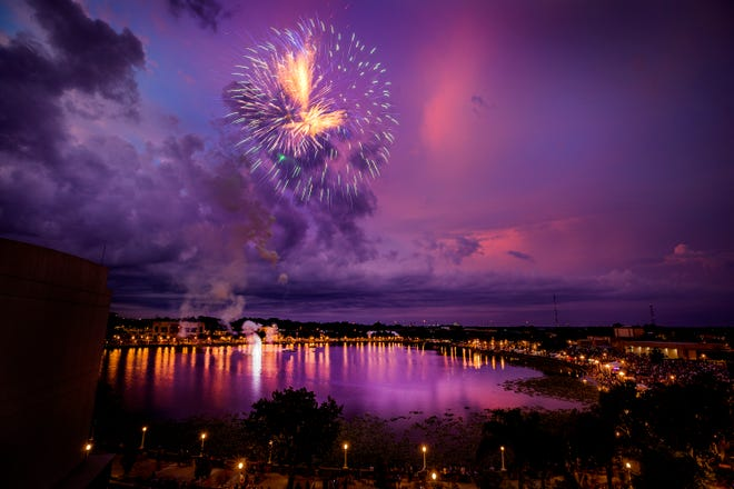Fireworks explode over Lake Mirror during the Red White & Kaboom celebration at the Frances Langford Promenade on Lake Mirror in Lakeland Fl. Wednesday July 3, 2019. ERNST PETERS/THE LEDGER