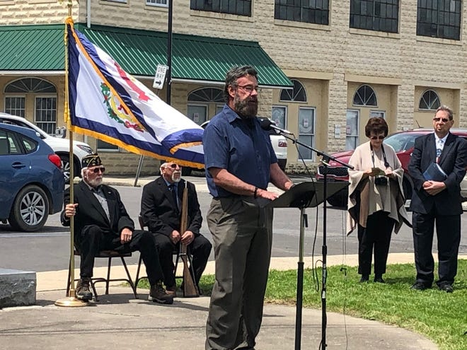 """Kevin Shreve sings """"Pray"""" during Keyser's National Day of Prayer observance Thursday on the front lawn of the Mineral County Courthouse."""