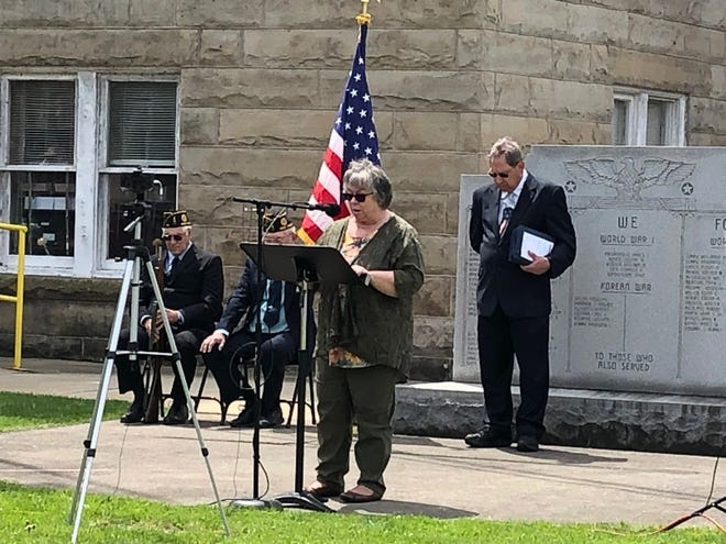 Pastor Donna Leatherman of Emmanuel Pentecostal Holiness  Church in Keyser, prays for area churches and pastors during the National Day of Prayer observance Thursday.