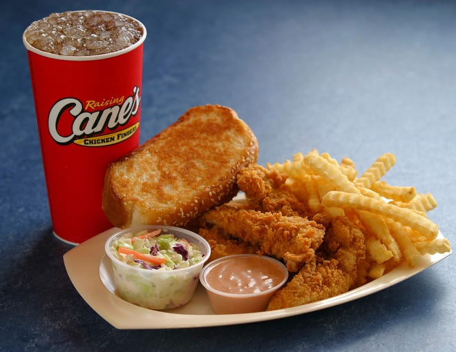 Raising Cane's Restaurant is known for its chicken finger-focused menu, which also includes crinkle cut fries, coleslaw, Texas toast and homemade Cane's sauce.