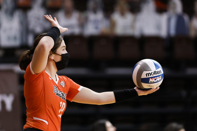 Bowling Green State University defensive specialist Taylor Haberland prepares to serve. Haberland, a 2017 Bedford graduate, was a key piece to the Falcons' MAC championship and NCAA tournament berth.