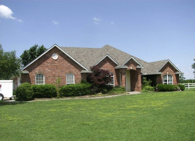 Dakil Auctioneers will auction this house and other surplus property for the Oklahoma Turnpike Authority on May 20.