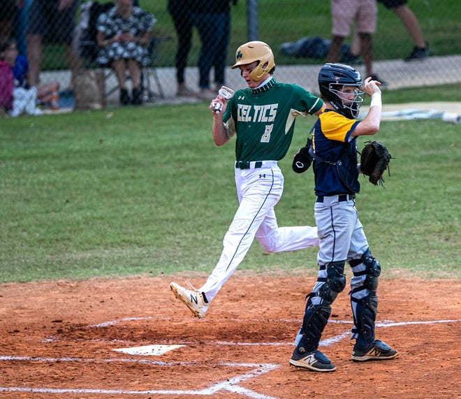 Trinity Catholic's Cole Gonzales scores a run against Trinity Prep as the Celtics defeated the Saints, 9-0, in the Class 3A Region 2 quarterfinal.
