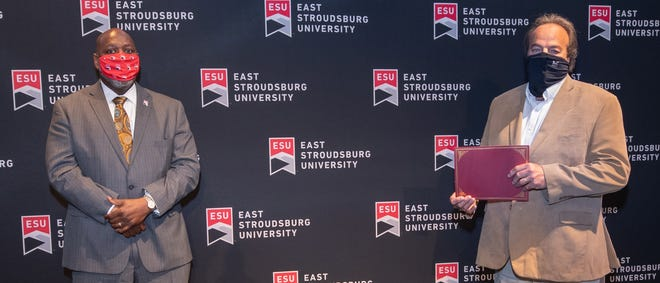East Stroudsburg University Interim President, Kenneth Long (left) poses with Mike Terwilliger, assistant football coach during an Employee Recognition Ceremony. Terwilliger was honored for his 40 years of service to ESU.
