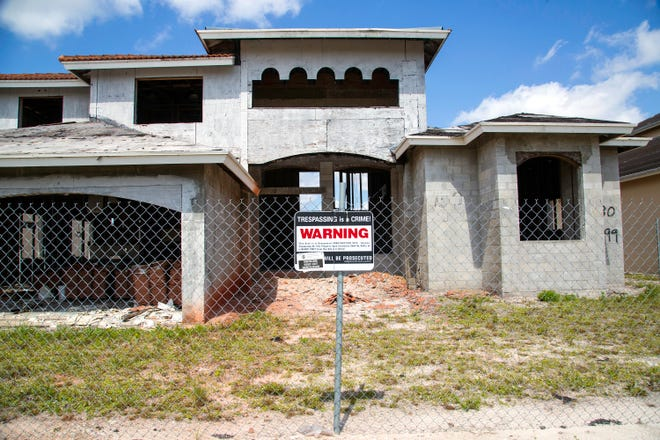 9299 Pearch Lane, one of the seven homes in the Estates of Boynton Waters that are scheduled for demolition, Friday, May 7, 2021. County officials expect to demolish the seven unfinished homes at the development west of Boynton Beach.