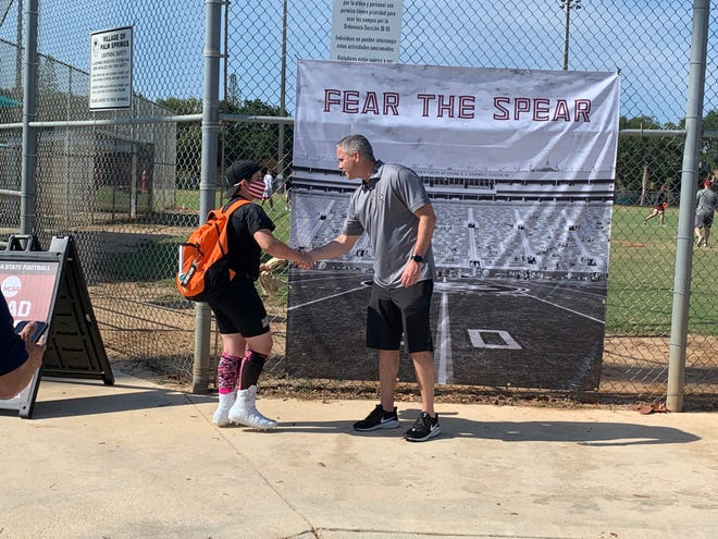 FSU coach Mike Norvell greets a camper at the Seminoles' youth football camp Thursday night in West Palm Beach.