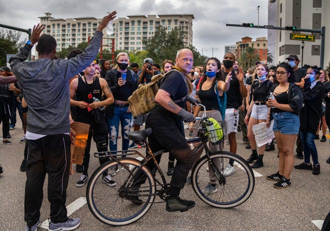 Marchers in downtown West Palm Beach in June, 2020, protesting the death of George Floyd.