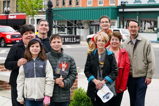 Three generations of the Mills family were on hand Thursday to see Ravenna's Honorary Way named for Gene Mills. On the left are Scott and Becky Brogan in front of Dara and Garrett Brogan. On the right are Mitchel Brogan in the back behind Nicole and Lenny Reiter, with Carol Mills in front.