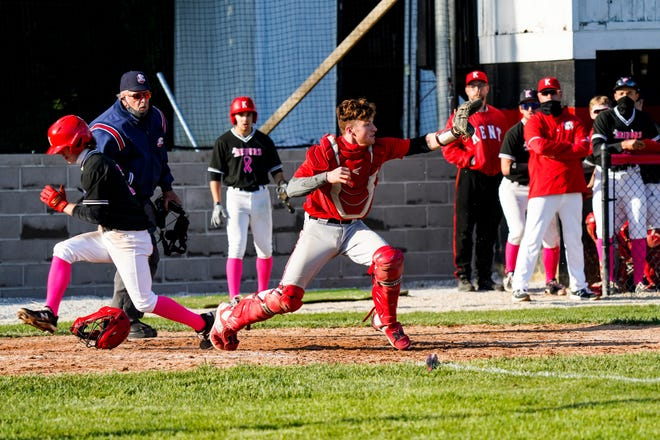 Nathan Fletcher comes across home plate with the winning run Friday.