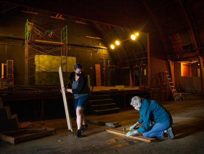 Jessica Ruth Baker, development and marketing coordinator for the Very Little Theatre, left, and volunteer Martha Greaney join a crew working to strip the theater interior as part of an extensive remodel that will last through 2021.