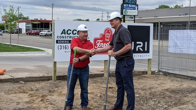 Scott Redler, left, COO of Freddy's Frozen Custard and Steakburgers, and Jason Ingermanson, right, CEO of JRI Hospitality and franchise owner for Freddy's in Salina, shake hands as they officially break ground at a new prototype Freddy's location at 916 E. Crawford St.