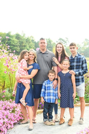 Jessie Hamrick is photographed along with her husband, Lindsay Hamrick, and children, Lindsey Grace, Lex, Hattie, Olivia and James.