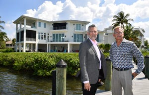 Premier Sotheby's managing broker Craig Cerreta, left, and sales associate Robert Sherman, stand on the dock of their listing at 1604 Baywinds Lane in Sarasota. The home, which has a view of Siesta Key and the Intracoastal Waterway, is listed for $6.49 million.