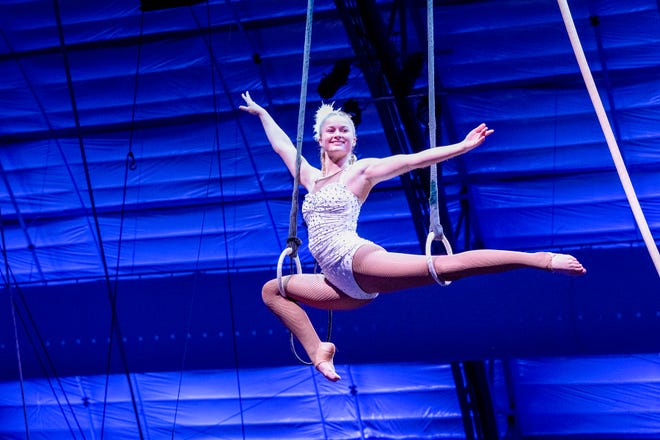 """Kaylee Dutkiewicz performs on the Roman Rings in the Sarasota Sailor Circus show """"A Night at the Movies."""""""