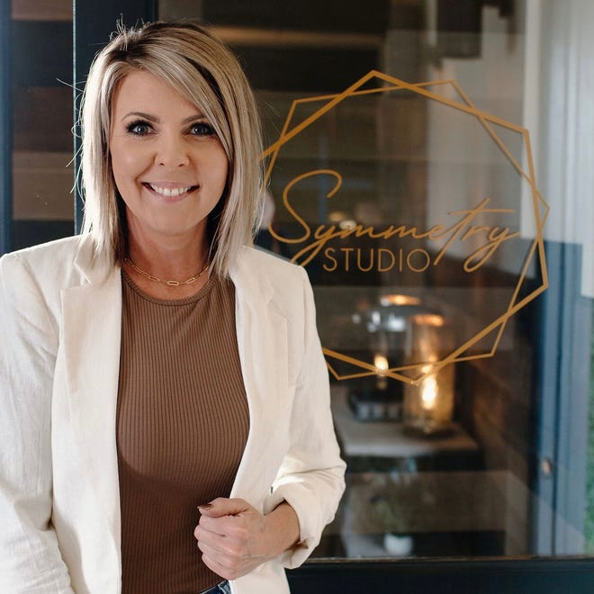 Heather Atkinson, as pictured, with her business, Symmetry Studio, at 2104 Ashmun St.