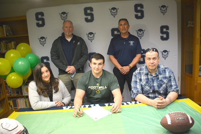 Sault High's Daylan Lujan has signed to play football at St. Norbert College. Daylan, front row center, is pictured with his parents, front left, Debra Lujan and at right, Justin Lujan; and back row, from left: Sault High football assistant coach Gordi Campbell and Sault High football head coach Scott Menard.