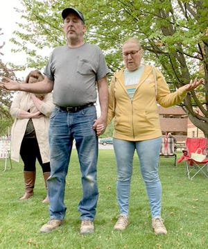 Tom and Marlene Hagerman joined in praise on National Day of Prayer. A local event took place on the courthouse grounds in Centreville.