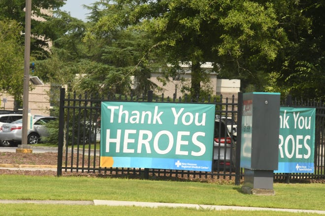 A sign thanking health care heroes hangs outside New Hanover Regional Medical Center over the summer. Nurses said support from the community was vital in getting through a year in the COVID-19 pandemic.