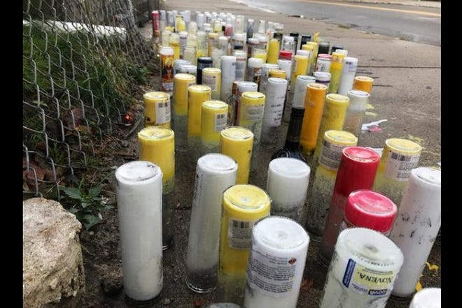 Candles left on Ashley Blvd in New Bedford in this file photo from 2019 where a 17-year-old was gunned down