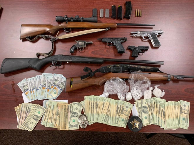 A search resulted in the confiscation of 80 grams of methamphetamine and 22 grams of fentanyl/opioid. Also recovered were seven firearms and $9,189.00 in US currency.