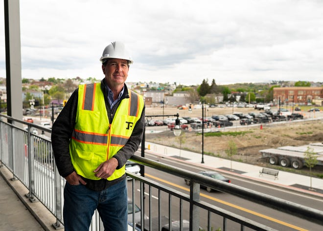 Denis Dowdle of Madison Properties stands in Polar Park with the development site south of Madison Street behind him.