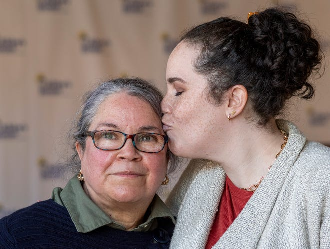 Rose Rodriguez kisses her mother, Janet DeJesus, Thursday at Abby's House in Worcester.