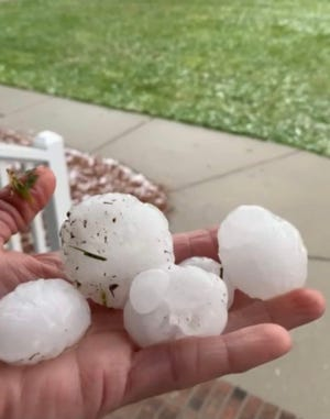Hail-covered roadways in Elizabethtown as storms rolled through Friday morning.