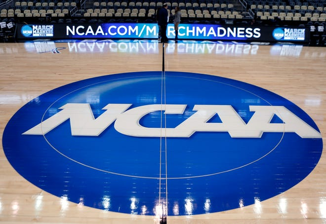 The NCAA logo is displayed on a basketball court.