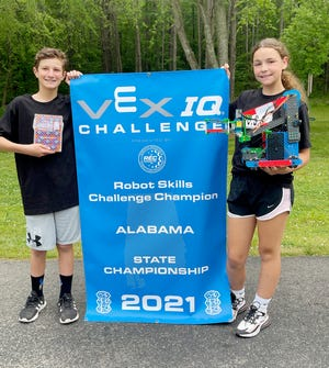 Charlie Craft and Shelby Abernathy are shown with the banner they received for winning the Alabama state championship in the Vex IQ Robot Skills Challenge. Charlie, an Etowah Middle School student, and Shelby, who attends Sardis Middle, will complete virtually in the world tournament May 27-29.