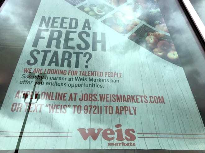 A job opportunity sign hangs in the window at Weis Markets in Stone House Square shopping center in Hagerstown on Friday, May 7.