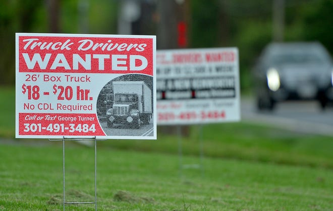 """A sign stating """"Truck Drivers wanted"""" is posted off Marsh Pike just north of Hagerstown on Friday, May 7."""