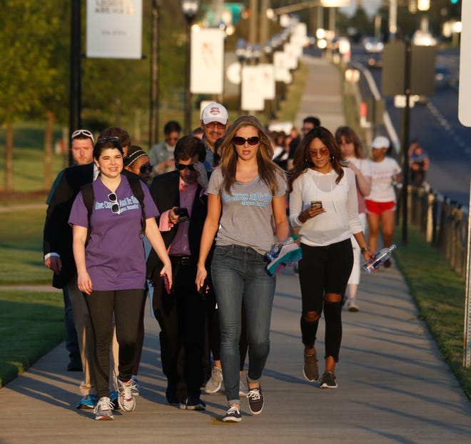 People gather and march in support of Megan Rondini along University Blvd. in Tuscaloosa Friday, September 8, 2017. [Staff Photo/Gary Cosby Jr.]